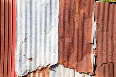 corrugated iron: Old damage rusty zinc plat wall
