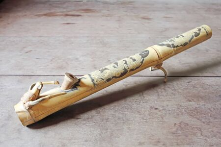crack pipe: Old  Bong bamboo side.Vietnam style Stock Photo