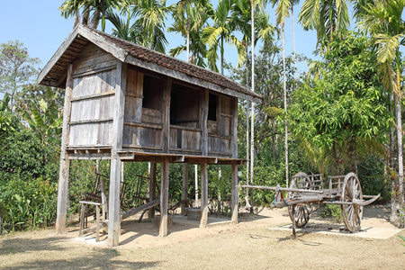 Wooden barn behind the country house of Thai farmer. photo