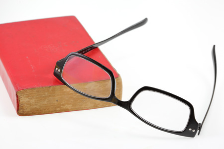 red book: Red book and eyesglass on white background