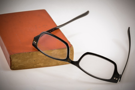 red book: Red book and eyesglass on vintage style Stock Photo