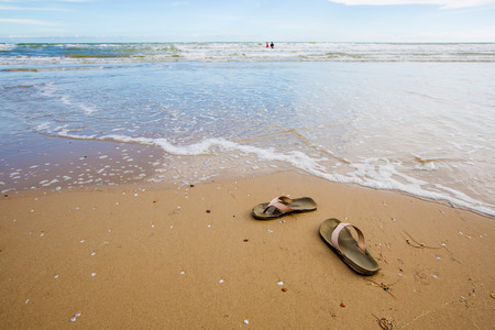 sandles: Old beach sandals  on a sandy beach