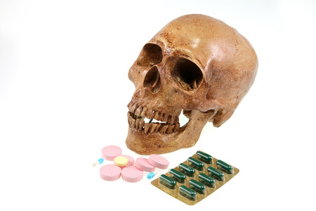 diferent: Skull and diferent Tablets pills capsule heap mix therapy drugs Stock Photo