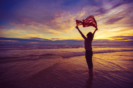 scarf beach: Freedom Concept. Beautiful Girl With  Scarf on The Beach enjoying summer.vintage style. Stock Photo