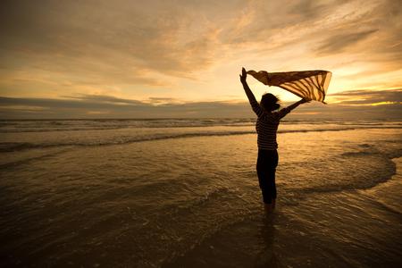 scarf beach: Beautiful Girl With  Scarf on The Beach enjoying summer.