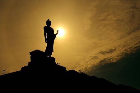 thai buddha: Thai buddha statue over scenic sunset sky background Stock Photo