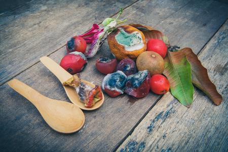 perish: Rotten Vegetables on old wooden. still life style Stock Photo