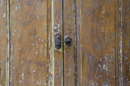 old furniture: vintage old key lock on wooden door.