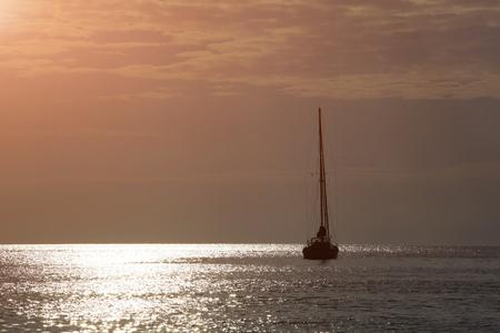 boat with orange sunset