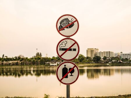 nicotine: prohibition Signs are on the edge of a swamp.