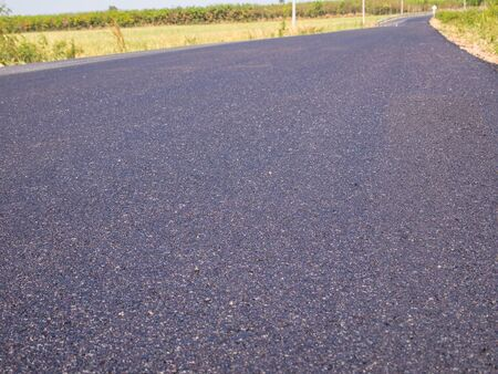rural development: Beautiful new black asphalt road done in rural and remote areas. Stock Photo