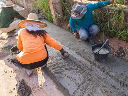 durability: Workers were plastering on the edge of the road.