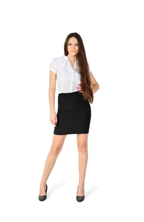 beautiful girl wearing skirt and shirt stands isolated on white background photo