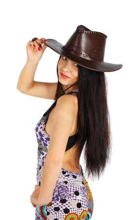 Beautiful girl wearing dress and leather hat touches hat isolated on white background photo