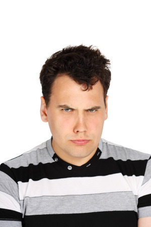 suspected: Portrait of brunet handsome suspecting man isolated on white background.