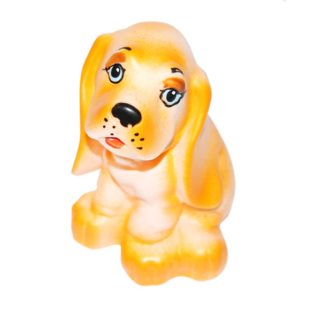 deplorable: Small rubber toy dog with sad snout isolated on white background  Stock Photo