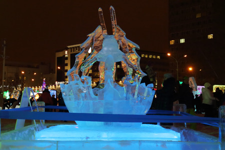 PERM, RUSSIA - JAN 11, 2014: Illuminated sculpture mountain skier at evening in Ice town, created in honor of Winter Olympic Games 2014 will be in Sochi, Russia.