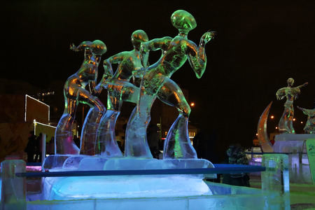 PERM, RUSSIA - JAN 11, 2014: Illuminated sculpture figure skating at evening in Ice town, created in honor of Winter Olympic Games 2014 will be in Sochi, Russia.