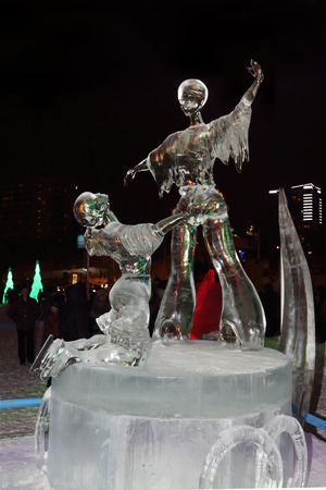 PERM, RUSSIA - JAN 11, 2014: Ice sculpture figure skating at night in Ice town, created in honor of Winter Olympic Games 2014 will be in Sochi, Russia.