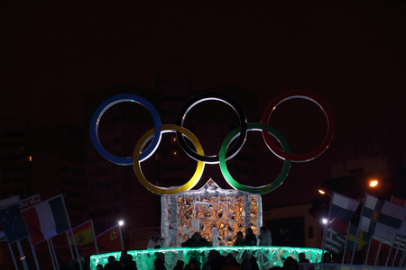 travel features: PERM, RUSSIA - JAN 11, 2014: Illuminated symbol of Olympic Games in Ice town at evening, created in honor of Winter Olympic Games 2014 will be in Sochi, Russia.