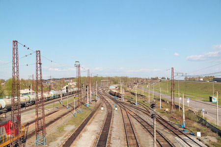 Freight trains at railway station with many old railroads at summer day photo