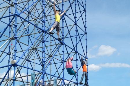 Figures climbing on frame at festival White Nights. photo