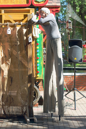 gorky: PERM, RUSSIA - JUN, 23, 2014: Man on stilts Puppet shows in Gorky Park Editorial