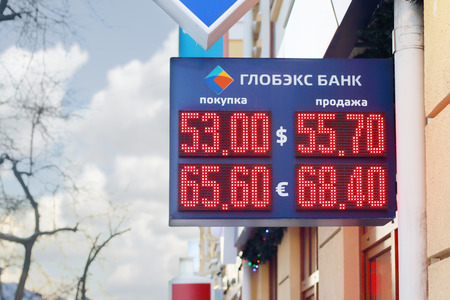 PERM, RUSSIA - DEC 9, 2014: Display Globex Bank with red digits exchange rates - dollar and euro. Due to conflict in Ukraine ruble falls and dollar strengthened