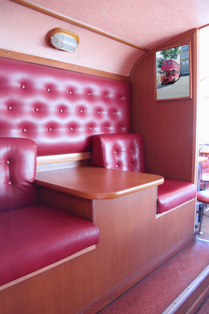 inferior: PERM, RUSSIA - JUN 11, 2013: Interior of bus cafe Kentucky Fried Chicken. First restaurant KFC was opened in 1930