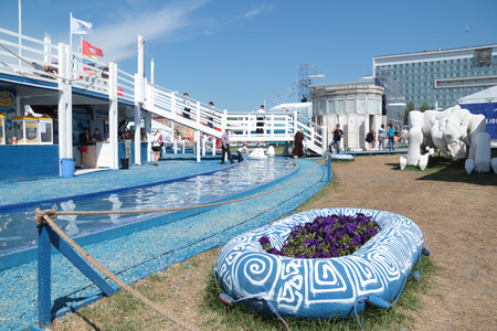 nights: PERM, RUSSIA - JUN 11, 2013: Decorative water channel and deck in festival town White Nights