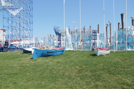 nights: PERM, RUSSIA - JUN 11, 2013: Stylized flowerbed in form of boats at festival White Nights in Perm