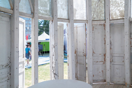 fluvial: , 2013: Inside structure of old doors and window frames at inetranational festival White Nights Editorial
