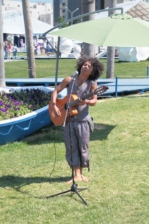 nights: PERM, RUSSIA - JUN 11, 2013: African singing and playing guitar on festival White Nights in Perm