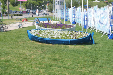 nights: PERM, RUSSIA - JUN 11, 2013: Flowerbeds of river ship at entrance to festival town at festival White Nights in Perm Editorial