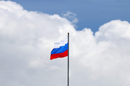 tricoloured: Evolving in wind Flag of Russian Federation on background of large white cloud