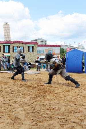 nights: PERM, RUSSIA - JUNE 25, 2014: Two men fencing swords at festival White Nights Editorial