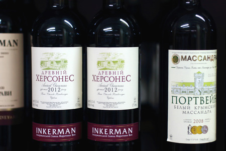annexed: PERM, RUSSIA - AUG 18, 2014: Crimean Massandra wine in Russian shop. Russia annexed  Ukrainian Crimean peninsula in 2014