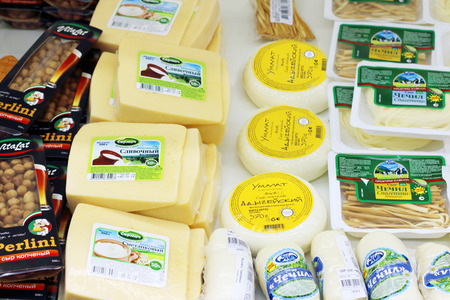 imposed: PERM, RUSSIA - AUG 18, 2014:Cheese in Russian shop. Russia has imposed sanction for European food, including cheeses