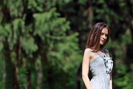 Close up to the waist of beautiful girl in dress with shallow depth of field photo