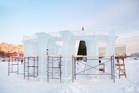 architectonics: Construction of sculpture with columns in Ice town in Perm, Russia