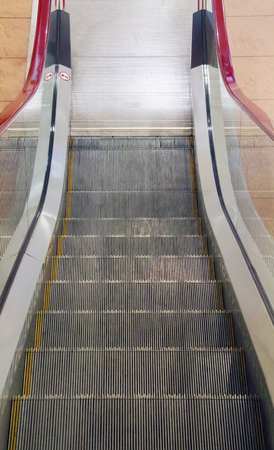 Metal stairs of new moving escalator in modern shopping center photo