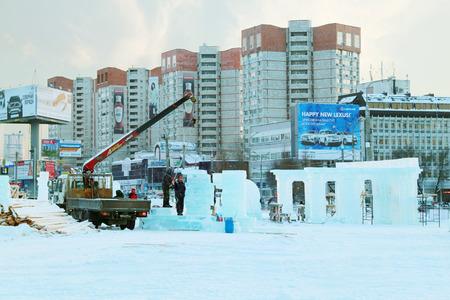 grandiose: PERM, RUSSIA - DEC 17, 2013: Construction of sculpture with columns in Ice town in Perm, Russia