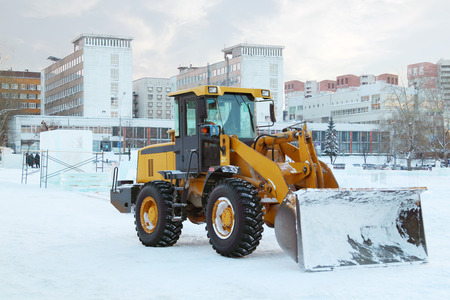 PERM, RUSSIA - DEC 17, 2013: Bulldozer after work in Ice town. Construction of ice town worth 268,000 dollars