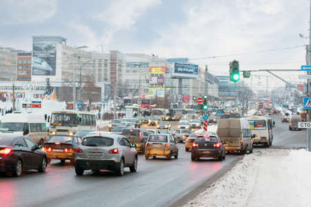 perm: PERM, RUSSIA - JAN 11, 2014: Cars going on street. In Perm region of about 1 million cars