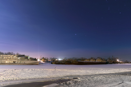 glory of the snow: Passenger ships in frozen river covered with snow at night and beautiful starry sky Stock Photo