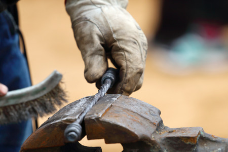 hand brushed: Closeup of blacksmith hand brushed metal forged products outdoor Stock Photo