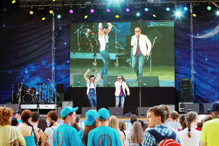 nights: PERM, RUSSIA - JUN 2, 2014: Singers perform on open air stage at festival White Nights Editorial