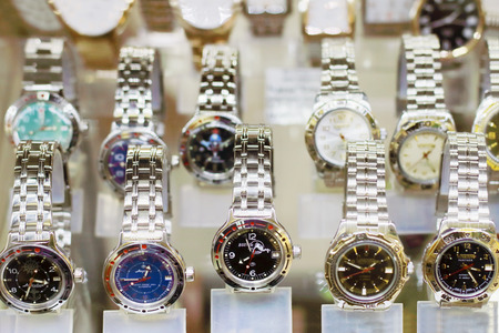 vostok: PERM, RUSSIA - AUG 18, 2014: Russian stylish wristwatches in showcase. Watch Factory Vostok produces popular wristwatch and was founded in 1941