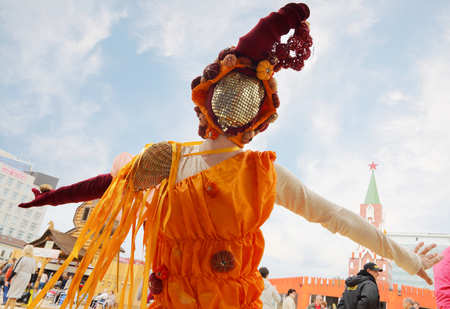 nights: PERM, RUSSIA - JUN 15, 2014: Woman in costume dances on street theaters show at open air White Nights Editorial