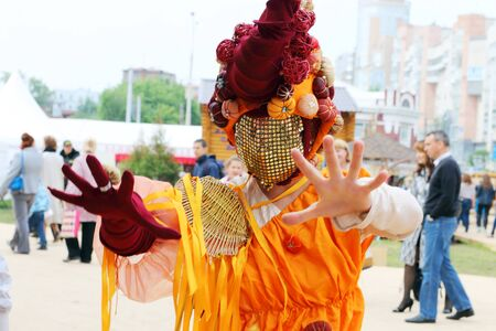 nights: PERM, RUSSIA - JUN 15, 2014: Woman in unusual mask poses during street theaters show at open air festival White Nights